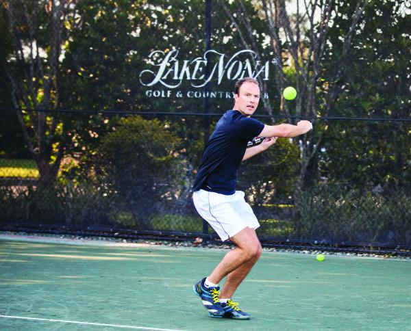 adult male tennis swing